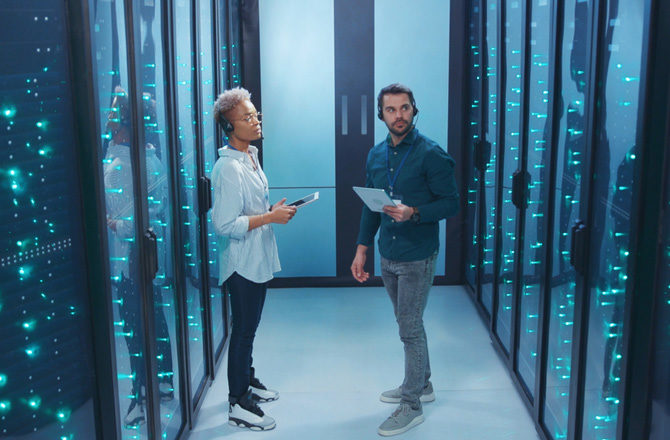 Two people in a data centre
